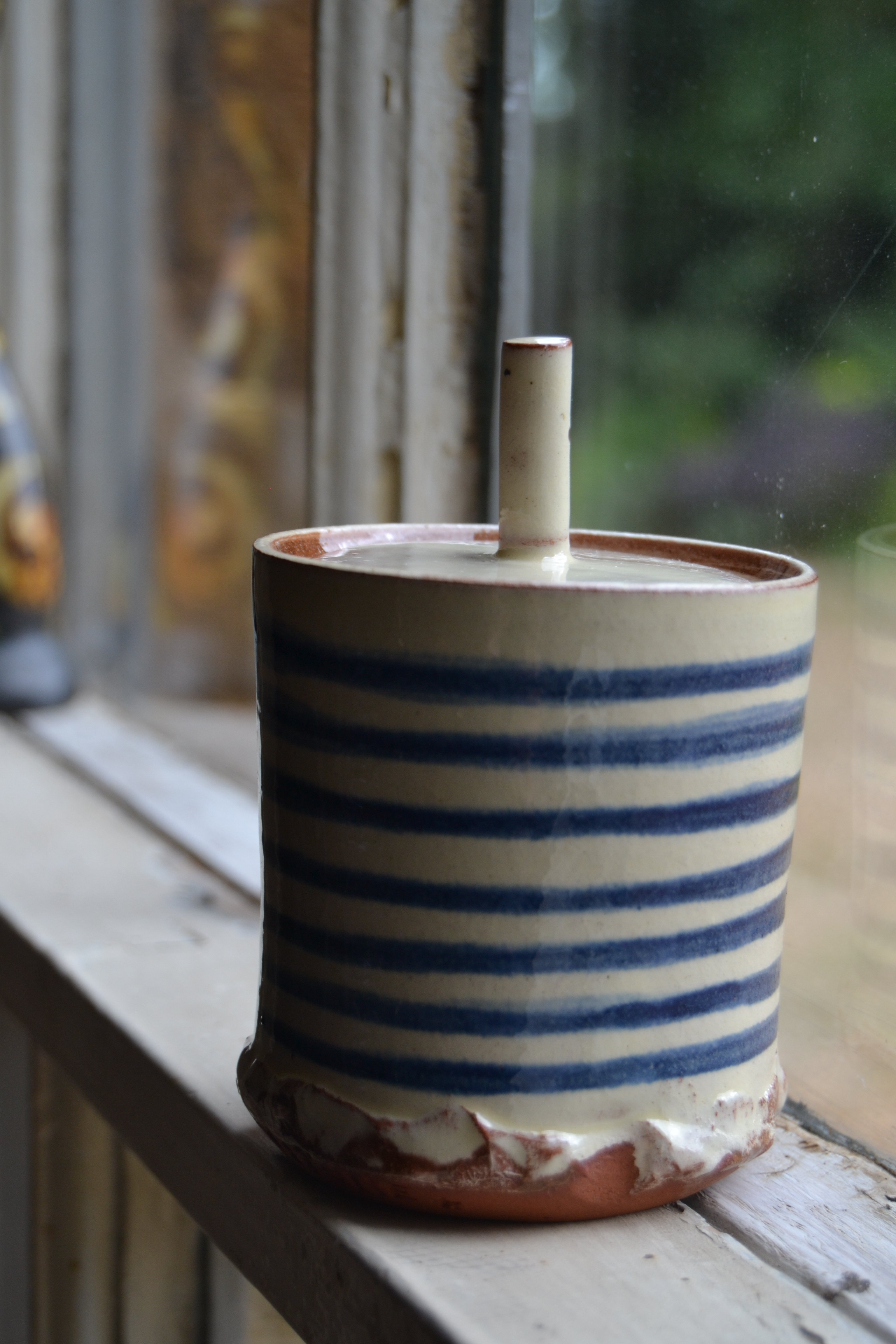 lidded pot on window