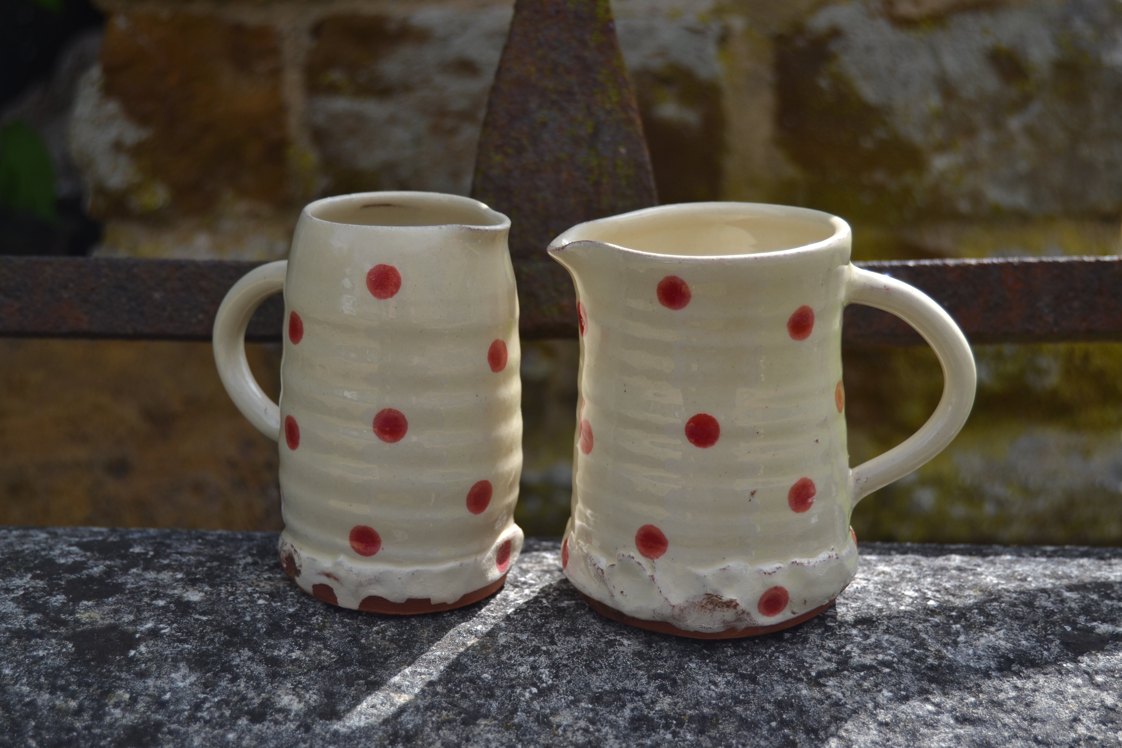 red spot jugs on roller